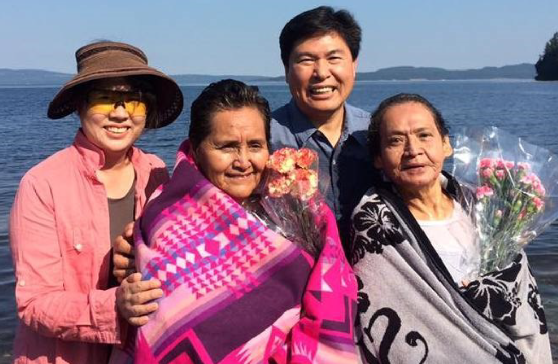 Rev. Joey Cho with his wife Insook Han and two newly-baptized members of the Stz'uminus First Nation